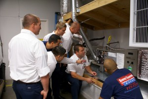 Training in our HVAC facility - Service Champions Heating & Air Conditioning